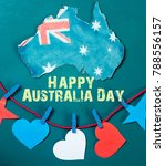 Small photo of Celebrate Australia-Day holiday on January 26 with a Happy Australia Day message greeting written card across Australian maps and flag hanging pegs on blue background.