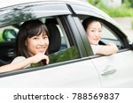 asian parent and daughter in a ... | Shutterstock . vector #788569837