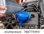 hand mechanic change pouring... | Shutterstock . vector #788775493