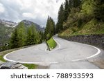 Small photo of 180 degree turn road in Alps