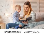 mother and son reading a book... | Shutterstock . vector #788949673