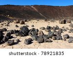 Volcanic rock scatters the center of Amboy Crater in the deserts of southern California