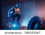athletic man jumping on fit box ... | Shutterstock . vector #789255367