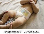 mother holding her cute baby   Shutterstock . vector #789365653