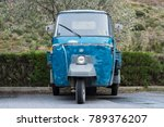 Small photo of Imperia, Italy - January 05, 2018: Blue Piaggio Ape car parked in a country road. This little pickup truck is a typical three-wheeled light commercial vehicle very popular in Italy.