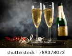 two champagne glasses in golden ... | Shutterstock . vector #789378073