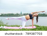 woman in a yoga pose with her... | Shutterstock . vector #789387703