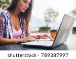 young woman typing on a laptop... | Shutterstock . vector #789387997