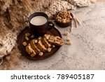 a cup of milk and crackers on a ... | Shutterstock . vector #789405187