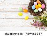 colorful easter eggs in nest...   Shutterstock . vector #789469957