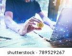 businessman holding bitcoin... | Shutterstock . vector #789529267
