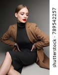 fashionable woman in a coat.... | Shutterstock . vector #789542257