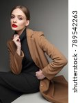 fashionable woman in a coat.... | Shutterstock . vector #789542263
