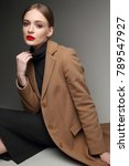 fashionable woman in a coat.... | Shutterstock . vector #789547927