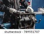 the mechanic installs a new... | Shutterstock . vector #789551707