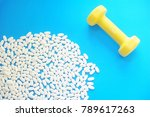 dumbbell and medical on blue... | Shutterstock . vector #789617263