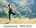 woman in tree yoga pose wearing ... | Shutterstock . vector #789672517