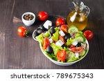 fresh greek salad made of... | Shutterstock . vector #789675343