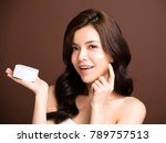 woman applying lotion cream on... | Shutterstock . vector #789757513