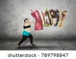 portrait of fat woman hitting