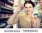 young woman customer deciding... | Shutterstock . vector #789830443