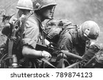 Small photo of Re-enactors of the Vietnam War Society wear uniforms and equipment of US riflemen of the Vietnam War this image was taken in Ashdown Forest England in 2001