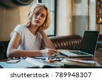 a teenage girl writing in a... | Shutterstock . vector #789948307