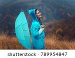 young happy woman in raincoat...   Shutterstock . vector #789954847