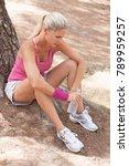 beautiful active woman sitting... | Shutterstock . vector #789959257