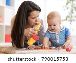 woman and baby playing musical... | Shutterstock . vector #790015753