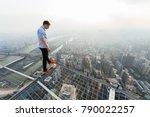 roofer stands on skyscraper... | Shutterstock . vector #790022257