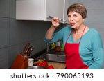 happy elderly woman cooking and ...   Shutterstock . vector #790065193