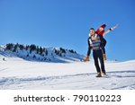 young couple having fun on snow.... | Shutterstock . vector #790110223