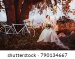 Small photo of Beautiful gride is swinging and smiling outdoors at decorated summer tree background.