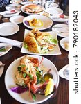 Small photo of Seafood Meal includes Alaska crab, Lobster and Salad are on the table.