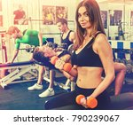woman holding dumbbell workout... | Shutterstock . vector #790239067