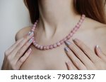 necklace of pink beads on the... | Shutterstock . vector #790282537