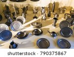 Small photo of SEDAN, FRANCE - JUNE 30, 2010: pewter dishes in museum of castle Chateau de Sedan. Sedan is a commune in Ardennes department, the castle began to be built in 1424