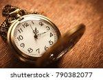 vintage pocket watch on wooden... | Shutterstock . vector #790382077