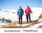 climbers walk through the snow... | Shutterstock . vector #790409263