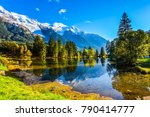 the lake reflects the forest... | Shutterstock . vector #790414777