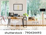 plastic chair at desk with... | Shutterstock . vector #790434493