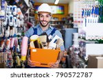 smiling man builder with tools... | Shutterstock . vector #790572787