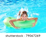 child on inflatable ring in... | Shutterstock . vector #79067269