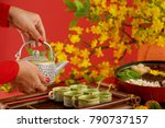 hands of woman pouring green... | Shutterstock . vector #790737157