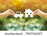 woman hand holding home and car ... | Shutterstock . vector #790744207