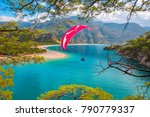 paraglider flies in the sky  ... | Shutterstock . vector #790779337