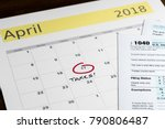 calendar on top of form 1040... | Shutterstock . vector #790806487