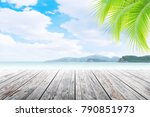 empty wooden table and palm... | Shutterstock . vector #790851973