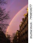 rainbow on a purple sky over... | Shutterstock . vector #790853077